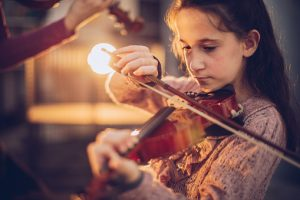young girl playing violin.